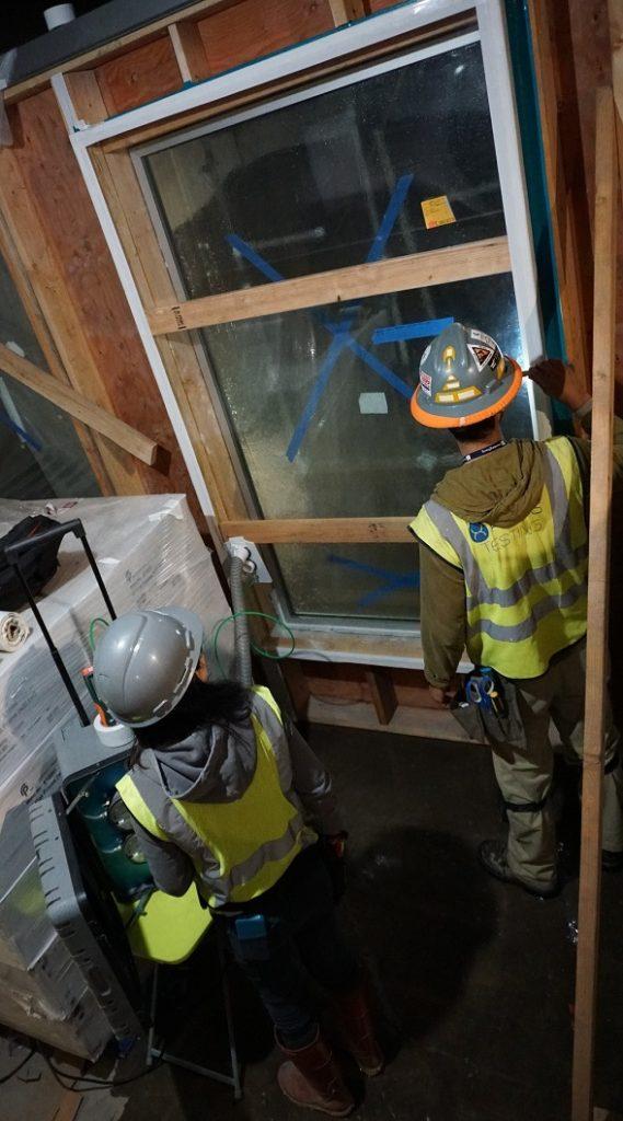 Terra-Petra Building Waterproofing crew checking for leaks.